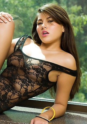 Shyla Jennings pulls off her black lace teddy and climbs onto a poses window ledge to strike several sexy and erotic poses to show off her flexible an